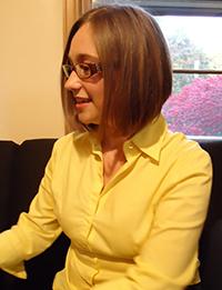 A side profile of Ashley Hinck in a yellow shirt
